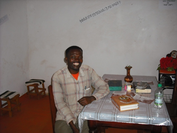Worku at the table in his home
